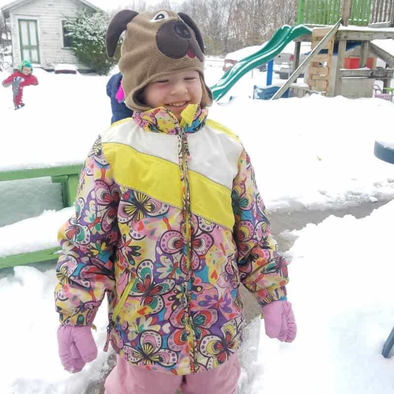 Dressed in snow clothes and playing in the snow