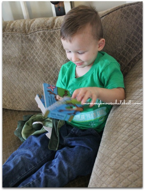 toddler with puppet book