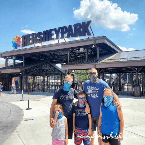 family wearing neck gaiter face masks