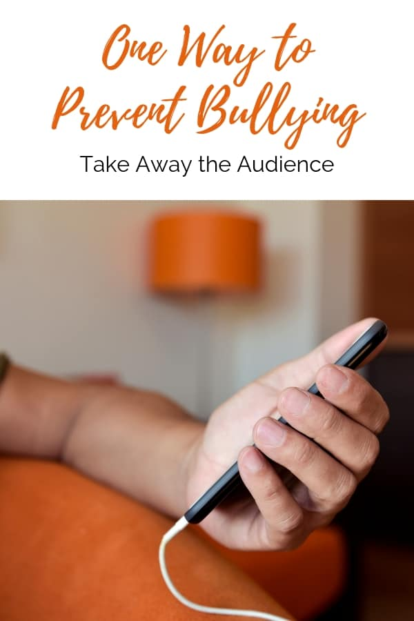 How to Prevent Bullying   hand holding smartphone